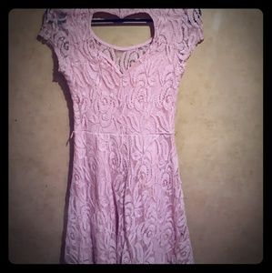 Women's pink lace dress with heart shaped back